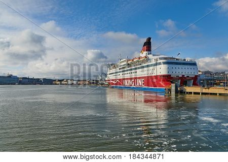 HELSINKI, FINLAND - MARCH 30, 2017: Viking Line ferry in port in Helsinki. The Finnish company operates ferries to Aland, Sweden and Estonia.