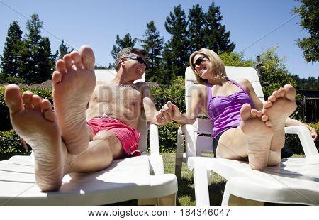 Caucasian couple sunbathing