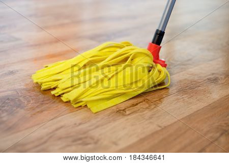 Cleaning mop tool on wooden parquet floor poster