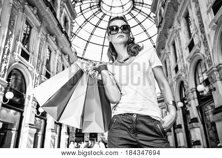 Fashion Woman With Shopping Bags In Galleria Vittorio Emanuele