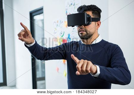 Graphic designer using the virtual reality headset in creative office