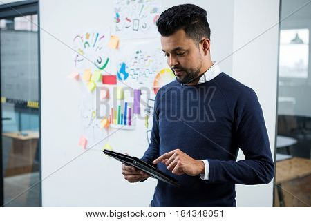 Graphic designer using graphic tablet in creative office