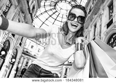 Fashion Woman With Shopping Bags Taking Selfie In Galleria