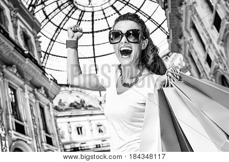 Happy Fashion Woman With Shopping Bags Rejoicing In Galleria