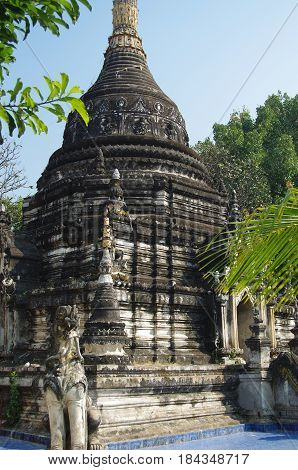 Old large Temple Stupa blackened by years of weathering.