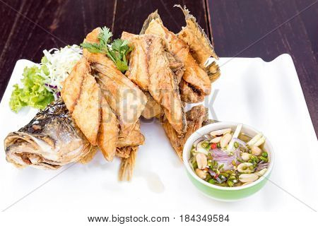 Sea bass fried with fish sauce with spicy mango sauce