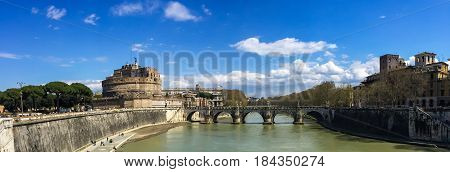 Panoramic view of Castel Sant'Angelo and its bridge over river Tiber in Rome Italy