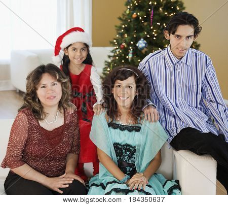 Hispanic family smiling at Christmas