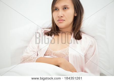 Woman with insomnia Relationships and problems with sleep concept - family couple in bed