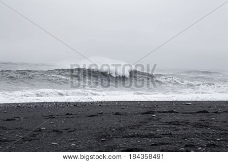 Waves in the beautiful volcanic black sand beach in Dyrholaey near Vik, Iceland.