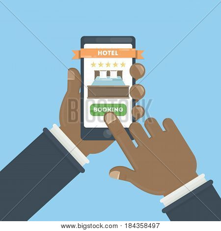 Online hotel booking. Hands holding smartphone to book a room in the hotel.
