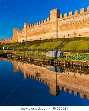 Walled city of Cittadella, brick wall mirror reflected in the water, province of Padua, Italy