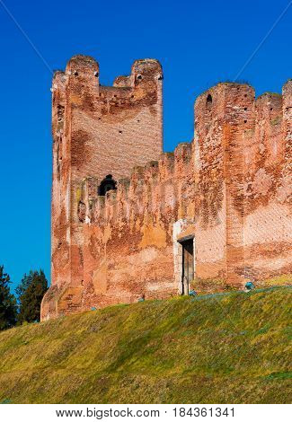 Old medieval tower made of red bricks, walled town in the province of Treviso, Northern Italy