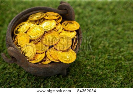 St. Patricks Day pot filled with chocolate gold coins on grass