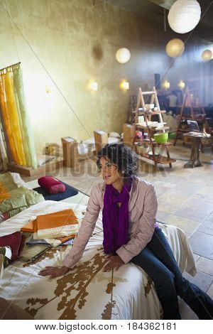 Ecuadorian woman looking at fabric in shop