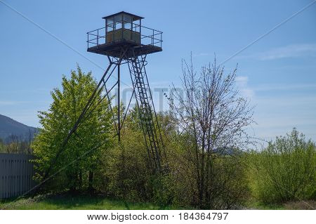 Abandoned rusty sentry box tower ( watchtower )