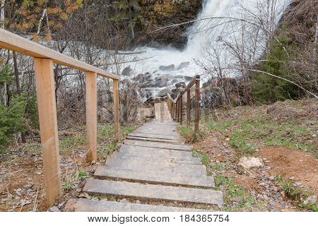 Wooden Ladder To Waterfall. A Ladder To The River.