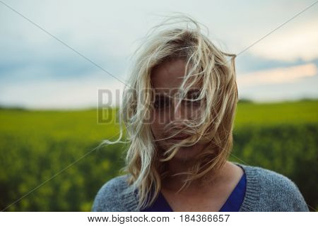 woman with long, disheveled hair