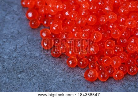 Placer of red caviar on a table