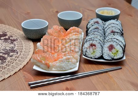 Two Plate Of Maki Sushi Rolls And Nigiri Sushi With Salmon And Shrimp Japan Food On The Table With S