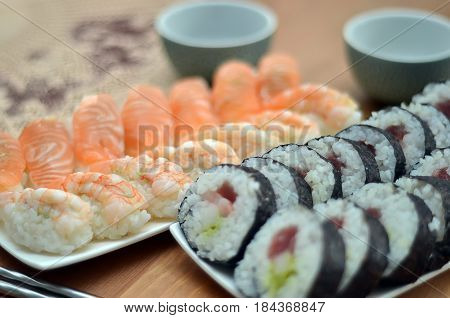 Detail Of Maki Sushi Rolls And Nigiri Sushi With Salmon And Shrimp Japan Food On The Table