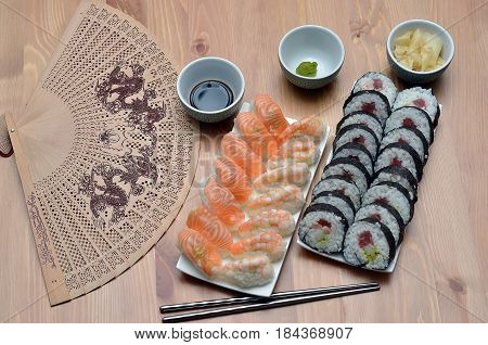 Maki Sushi Rolls And Nigiri Sushi With Salmon And Shrimp Japan Food On The Table With Soy Sauce And