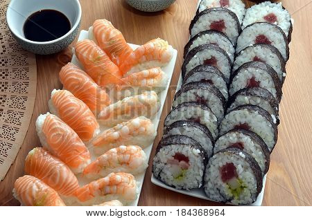 Maki Sushi Rolls And Nigiri Sushi With Salmon And Shrimp Japan Food On The Table