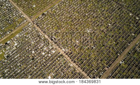 Full frame abstract background texture of a vertical high aerial drone view looking down onto the rows of graves in a North London cemetery.