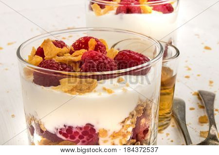 scottish dessert raspberry cranachan with whipped cream and corn flakes