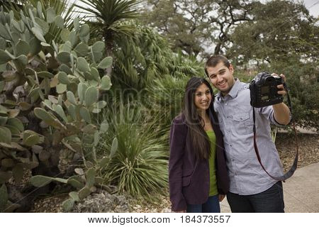 Couple taking self-portrait with digital camera