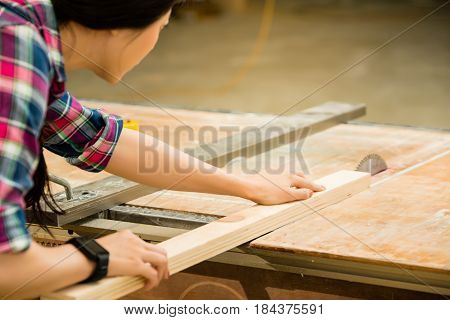 Woman Working On An Electric Buzz Saw