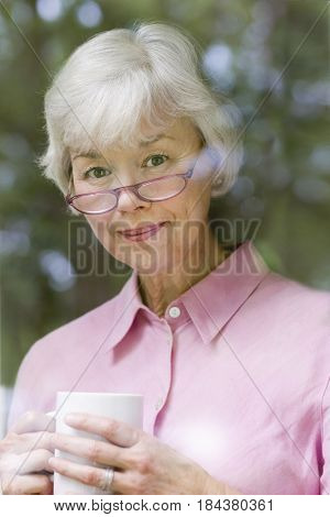 Serious mixed race woman drinking coffee