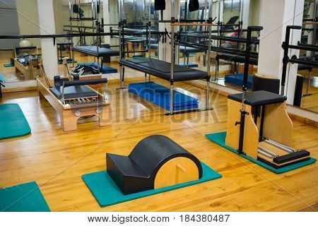 Empty fitness studio with different gym equipment