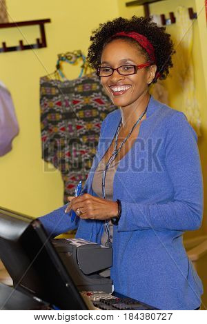 Small business owner in clothing shop