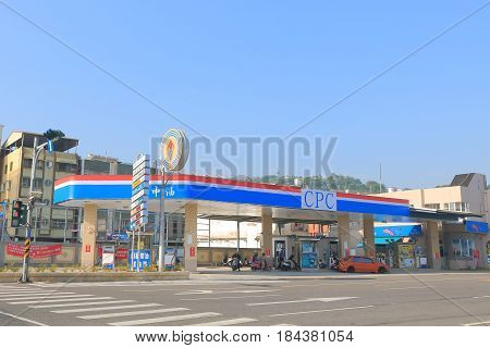 KAOHSIUNG TAIWAN - DECEMBER 13, 2016: Unidentified people buy petrol at CPC petrol station. CPC is a state-owned petroleum, natural gas, and gasoline company in Taiwan.