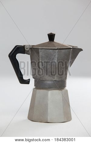 Close-up of metallic coffee maker on white background