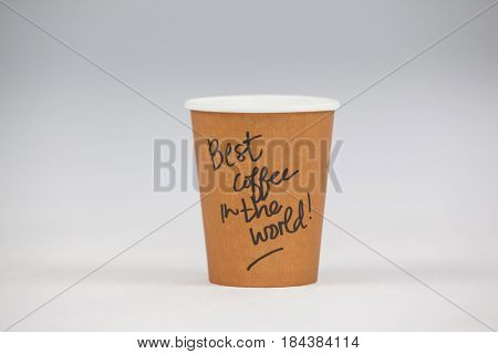 Take away disposable coffee cup with written text on white background
