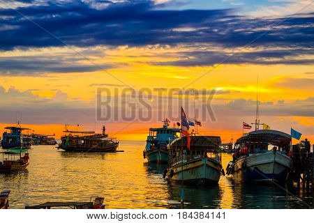 Sunset Over Pier Of Traditional Wooden Boat , Tranquil Kao Tao Island