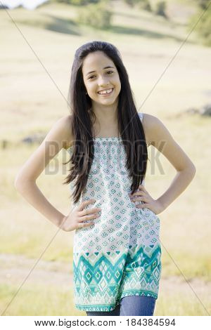 Hispanic girl standing with hands on hips