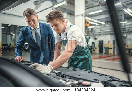 Mechanic and customer in garage