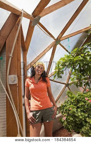 Ecuadorian woman posing in greenhouse