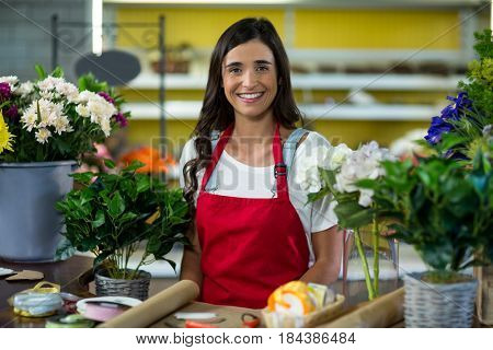 Smiling florist standing at the counter in florist shop