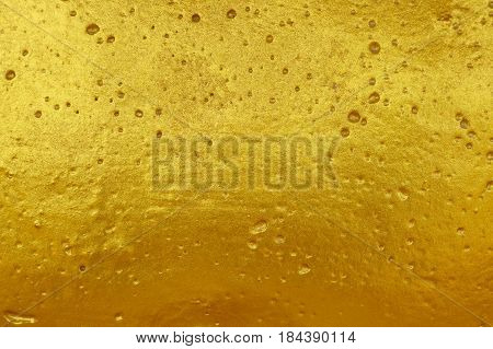 Cement wall, gold surface is not smooth for the background.