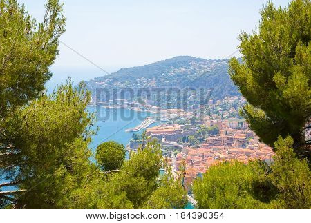 Beautiful Landscape of the Cote d'Azur. Aerial View of bay Luxury resort Villefranche-sur-Mer on French Riviera at Mediterranean Sea between Nice and Monaco. Amazing cityscape. Europe. France.