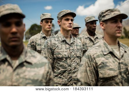 Group of military soldiers standing in boot camp
