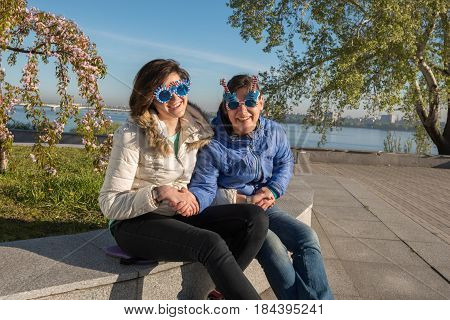 Happy Mother And Adult Daughter In A Funny Sunglasses Are Having Fun