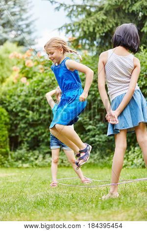 Girls have fun jumping and playing chinese jump rope game