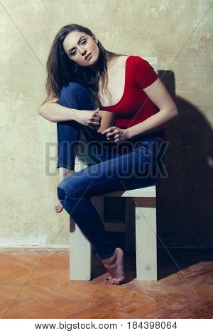 Pretty Girl Sitting On White Wooden Chair With Brown Cups