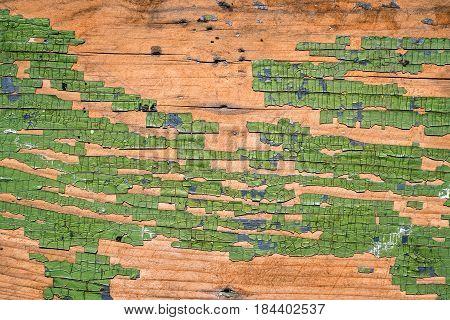 Vintage wood plank with peeling paint .