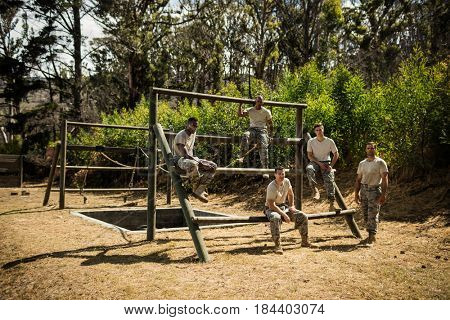Portrait of soldiers sitting on the obstacle course in bootcamp